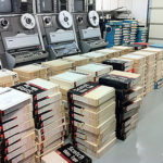 Many Quad tape boxes on floor